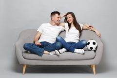 Joyful couple woman man football fans in white t-shirt cheer up support favorite team with soccer ball, hugging isolated royalty free stock photos