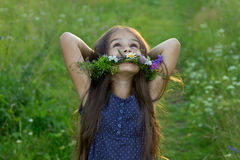 Joyful cute little girl on the summer meadow Royalty Free Stock Image