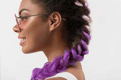 Joyful cute teenager with glamour violet pigtails Stock Image