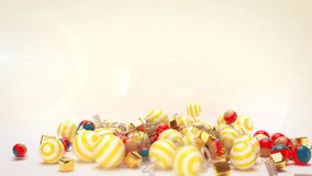 Rolling Celebratory Multicolored Balls. A joyful 3d illustration of rolling celebratory colorful striped balls with golden spirals and cubes in the white Stock Image