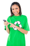 Joyful dark haired environmental activist using a mobile phone Royalty Free Stock Image
