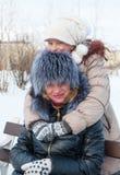Joyful daughter hugging his mother. Royalty Free Stock Photo