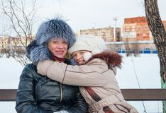 Joyful daughter hugging his mother. Stock Photography