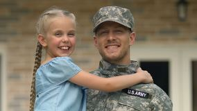 Joyful daughter looking at father military uniform, soldier homecoming, patriot. Stock footage stock video