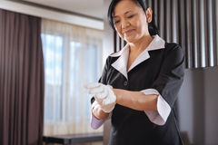 Joyful delighted hotel maid preparing to work Royalty Free Stock Images