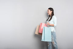 Joyful delighted woman holding packages Royalty Free Stock Photos