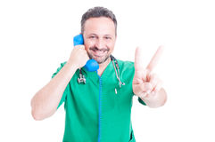 Joyful doctor with classic receiver Royalty Free Stock Images