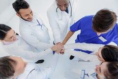 Joyful doctors are proud of their teamwork Royalty Free Stock Image