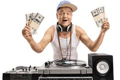 Joyful elderly DJ holding bundles of money Royalty Free Stock Photos