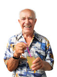 Laughing Elderly Man with Coctail. Very joyful elderly man holding a coctail in the glass with straw on white background Stock Photos