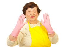 Joyful elderly showing hands in gloves Royalty Free Stock Images