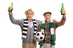 Joyful elderly soccer fans with scarves and bottles of beer Royalty Free Stock Photo