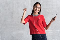 Joyful elegant girl is enjoying rhythmic song royalty free stock photos