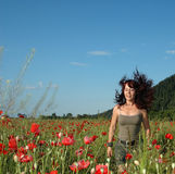Joyful emotions in a poppy field Stock Images