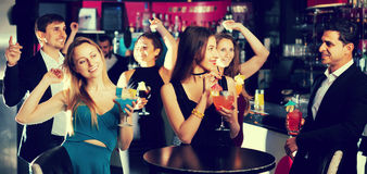 Joyful employees  dancing on corporate party. With alcohol in hands Stock Images