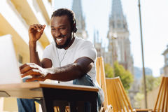 Joyful engaging guy happy seeing his friend Stock Photography