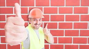 Joyful engineer or builder showing thumbs up Stock Image