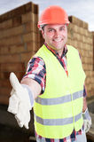 Joyful engineer doing welcoming gesture Royalty Free Stock Image