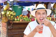 Joyful ethnic male at fruit market stock image
