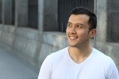 Joyful ethnic male smiling isolate with copy space royalty free stock image