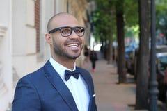 Joyful ethnic man wearing a tuxedo royalty free stock image