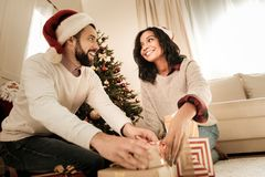 Joyful excited couple looking at the Christmas presents stock photography