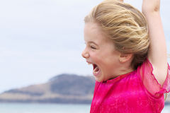 Joyful expression on little girl at beach Royalty Free Stock Image