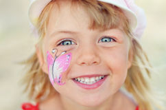 Joyful face of a beautiful little princess. Sincere happiness Royalty Free Stock Images