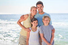 Joyful family at the beach Stock Images