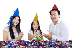 Joyful family in birthday party. Portrait of asian family celebrate child birthday, isolated on white background Stock Photography
