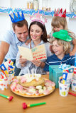 Joyful family celebrating mother's birthday Royalty Free Stock Images