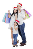 Joyful family with christmas gift. Asian family posing and smiling on camera while carrying shopping bags Stock Photos