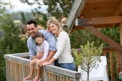 Joyful family enjoying holidays in cabin Stock Photos