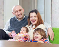 Joyful family of four at their home Stock Image