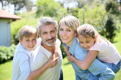 Joyful family in the garden Stock Photos