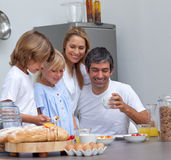 Joyful family having breakfast. In the kitchen Royalty Free Stock Images