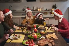 Joyful family having fun during festive dinner stock photos
