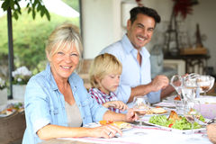 Joyful family having lunch Stock Photos