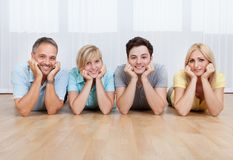 Joyful family with heads together Royalty Free Stock Images