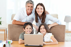 Joyful family looking at the camera Stock Images
