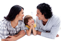 Joyful family lying on the floor Royalty Free Stock Photos