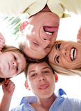 Joyful family making weird faces in huddle Royalty Free Stock Photo
