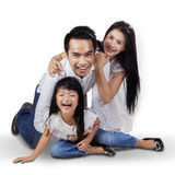 Joyful family playing in the studio. Three member of happy family playing together in the studio while laughing happily Stock Photos