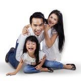 Joyful family playing in the studio Stock Photos