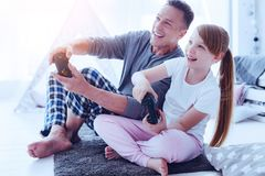 Joyful family playing video games together royalty free stock photography