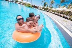 Joyful family in the pool. Happy family having fun in the swimming pool Stock Photography