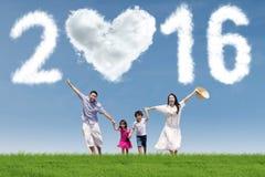 Joyful family running under numbers 2016 Stock Image