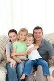 Joyful family sitting on the sofa Stock Photo