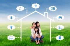 Joyful family and smart house design Royalty Free Stock Photos