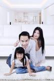 Joyful family smiling in living room Stock Photo